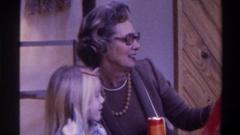 1975: grandmother bonding grandchild FLORIDA Stock Footage