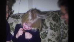 1973: grandma snuggling her grandchild. NEW YORK Stock Footage