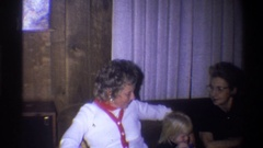 1973: old guys and young kids sitting on a sofa NEW YORK Stock Footage
