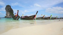 Longtail boats on seashore Stock Footage