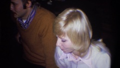 1973: adults having coffee at a gathering in 70s attire. pans out from blonde. Stock Footage
