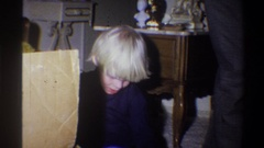 1973: excited boy opening a gift NEW YORK Arkistovideo