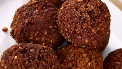 Rotating Fried Falafel (seamless loopable; 4K) Stock Footage