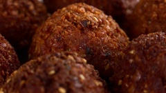 Falafel on a rotating wooden plate (seamless loopable; 4K) Stock Footage