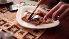 Close-up woman's hands cut the cake. Cutting Serving and Eating Sequence Stock Footage
