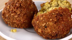 Egyptian Falafel (rotating on a wooden plate; seamless loopable; 4K) Stock Footage