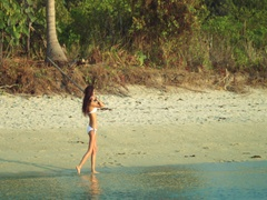 A Girl Walking On A Beach Of A Deserted Island Stock Footage