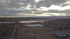 2016: view from an airplane of a city, boulevard, buildings, industrial area, Stock Footage