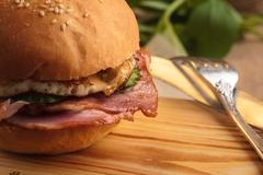 Trendy breakfast burger with ham and eggs Stock Photos