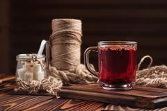 Hibiscus tea with fruit pieces and sugar Stock Photos