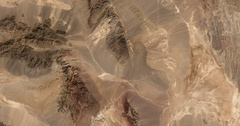 High-altitude aerial of rocky desert in Yazd and S Khorasan provinces of Iran. Stock Footage