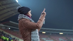 A fan girl taking pictures of a game Stock Footage