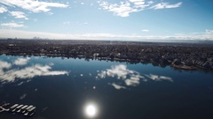 2016: airplane viewing of a lake and city. COLORADO Stock Footage