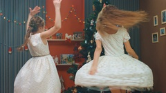Charming girls circling in dance near the Christmas tree Stock Footage