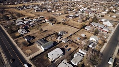 2016: flying overhead in a small desert city towards the body of water COLORADO Stock Footage
