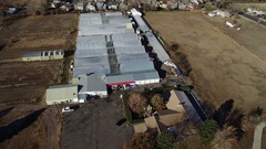 2016: aerial view of a compound with barrack type setup and fields on either Stock Footage