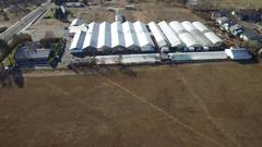 2016: aerial of industrial farmland and associated buildings COLORADO Stock Footage