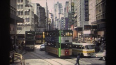 1982: a busy city street with cars, trolleys and people meandering along the Stock Footage