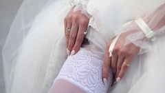 Bride corrects a stocking Stock Footage