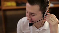 Young employee working with a headset in the call center. Stock Footage