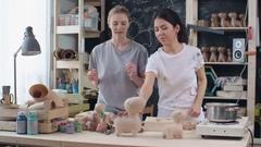 Women Making Papier Mache Toys Stock Footage