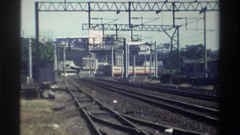 1982: parallel line of 4 to 5 railway tracks in a town side nearing to flyover Stock Footage