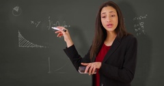 A Hispanic teacher takes questions from the class Stock Footage