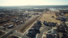 2016: flyover from a helicopter of a city suburb featuring houses, streets, and Stock Footage