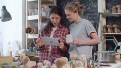 Artsy Women in Workshop Looking at Tablet Stock Footage