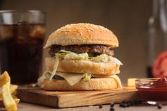 Classic beef double burger with ingredients Stock Photos