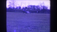 1963: an amphibious airplane starts a takeoff run on a grass airfield VOLMER Stock Footage