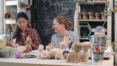Women Making Toys with Craft Paper Stock Footage