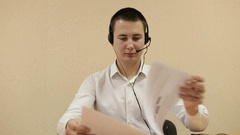 The employee call center reviews documents. Call center operators at work. Stock Footage