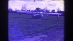 1963: a plane coasting down a grass field VOLMER YUCAIPA CALIFORNIA Stock Footage