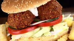 Rotating Falafel Burger with Chips (not loopable; 4K) Stock Footage