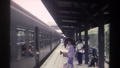1982: number of people are waiting in a railway platform TAIWAN Stock Footage