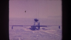 1959: a sea plane taking off out of a large body of water, moving away from the Stock Footage