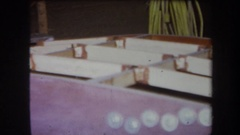 1964: wooden structure that is incomplete and with a black metal attachment Stock Footage