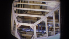 1965: a wooden framework fitted on the roof of a building VOLMER YUCAIPA Stock Footage
