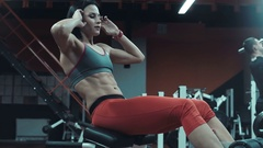 Woman doing crunch exercises for abdominal muscles Stock Footage