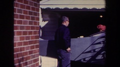1969: two men examine a partially built homemade aircraft parked in a home's Stock Footage