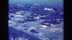 1967: a large area with lots of grass and buildings around HAWAII Stock Footage