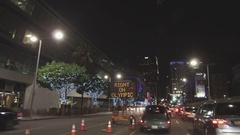 Driving In Front Of Staples Center and LA Live During An Event At Night Stock Footage