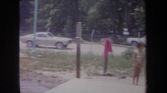 1968: some kids playing in a large body of water MICHIGAN Stock Footage