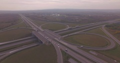 Big transport trucks on the road. Aerial view major intersection Stock Footage