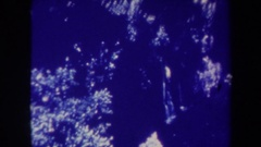 1967: beautiful waterfalls in the dense forest falling from great height HAWAII Stock Footage