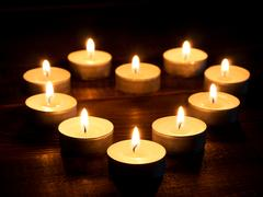 Hearth-shape from candle light Stock Photos
