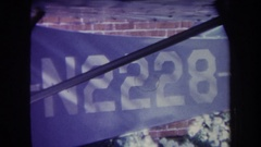 1969: id number n2228 is printed on narrowing panel placed between brick wall Stock Footage