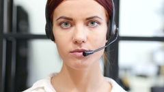 Close Up Of Serious Call Center Woman Face Stock Footage