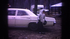 1968: boys walking with fishing gears near to a white car parked among trees Stock Footage
